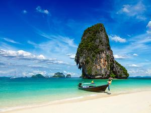 Long Tail Boat on Tropical Beach with Limestone Rock, Krabi, Thailand by f9photos