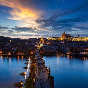 Night Aerial View of Prague Castle and Charles Bridge over Vltava River in Prague, Czech Republic. by f9photos