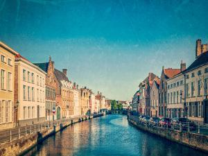 Vintage Retro Hipster Style Travel Image of Canal and Medieval Houses. Bruges (Brugge), Belgium Wit by f9photos