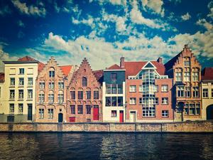 Vintage Retro Hipster Style Travel Image of Canal and Medieval Houses. Bruges (Brugge), Belgium by f9photos