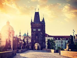 Vintage Retro Hipster Style Travel Image of Charles Bridge Tower in Prague on Sunrise, Czech Republ by f9photos