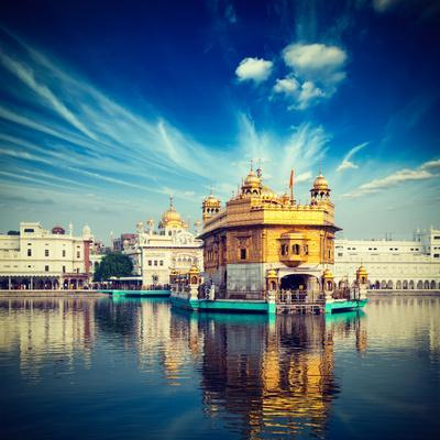 Vintage Retro Hipster Style Travel Image of Famous India Attraction Sikh Gurdwara Golden Temple (Ha