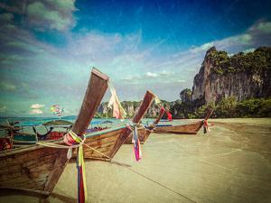 Vintage Retro Hipster Style Travel Image of Long Tail Boats on Tropical Beach (Railay Beach) in Tha by f9photos