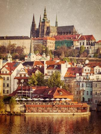 Vintage Retro Hipster Style Travel Image of Mala Strana and  Prague Castle over Vltava River with G