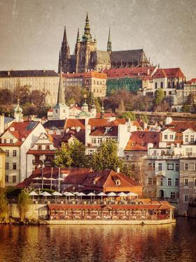Vintage Retro Hipster Style Travel Image of Mala Strana and  Prague Castle over Vltava River with G by f9photos