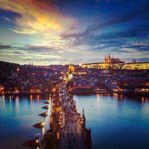 Vintage Retro Hipster Style Travel Image of Night Aerial View of Prague Castle and Charles Bridge O by f9photos