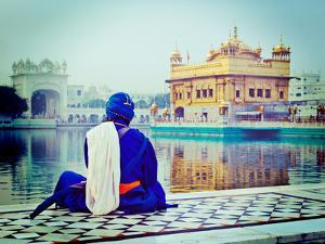 Vintage Retro Hipster Style Travel Image of Unidentifiable Seekh Nihang Warrior Meditating at Sikh by f9photos