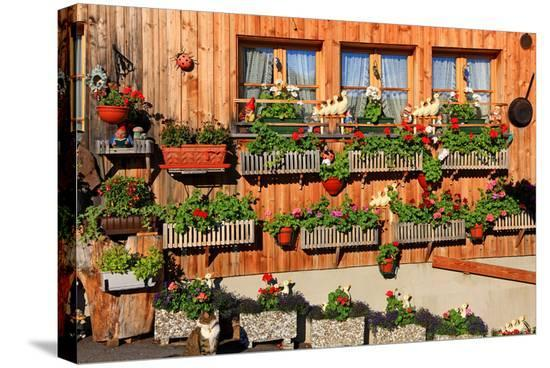 Facade of a Farmhouse decorated with Flowers, Beatenberg, Canton of Bern, Switzerland--Stretched Canvas