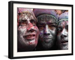 Faces Smeared with Colored Powder, Posing for a Photo During Holi Festivities in Gauhati, India