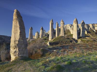 https://imgc.allpostersimages.com/img/posters/fairy-chimneys-in-the-liebestal-valley-tuff-stone-cappadocia-anatolia-turkey_u-L-Q11YLOD0.jpg?p=0