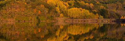 Fall colors reflected in lake at White Mound State Park, Wisconsin, USA