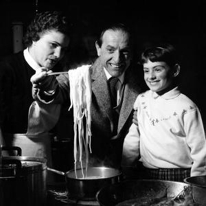 Family Preparing Fish and Pasta
