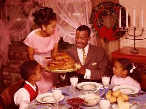 Family Preparing To Eat Christmas Dinner