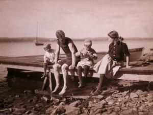 Family Sitting on Dock