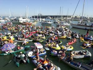 Fans Crowd into Boats, Kayaks, and Rafts Waiting for Their Chance to Catch a Home Run Ball