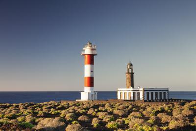 https://imgc.allpostersimages.com/img/posters/faro-de-fuencaliente-lighthouses-at-sunrise-punta-de-fuencaliente-la-palma-canary-islands-spain_u-L-Q12SELF0.jpg?p=0