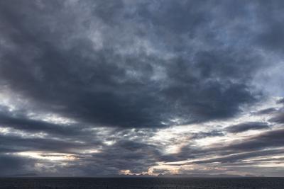 https://imgc.allpostersimages.com/img/posters/faroes-silhouette-arrival-clouds_u-L-Q1EYACK0.jpg?artPerspective=n