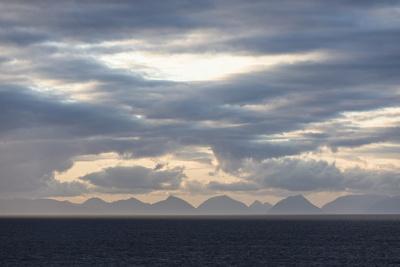https://imgc.allpostersimages.com/img/posters/faroes-silhouette-arrival-clouds_u-L-Q1EYCJA0.jpg?artPerspective=n