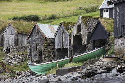https://imgc.allpostersimages.com/img/posters/faroes-vagar-bour-boathouses_u-L-Q1EY80K0.jpg?artPerspective=n