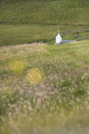 https://imgc.allpostersimages.com/img/posters/faroes-vagar-bour-steeple_u-L-Q1EYB7B0.jpg?artPerspective=n