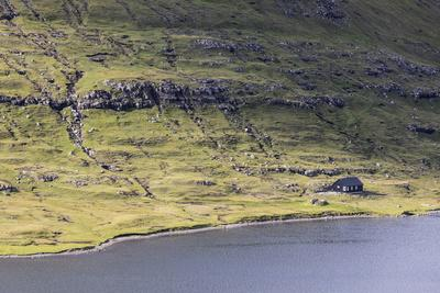 https://imgc.allpostersimages.com/img/posters/faroes-vagar-sorvagsvatn-leitisvatn-house-shore_u-L-Q1EYC8X0.jpg?artPerspective=n