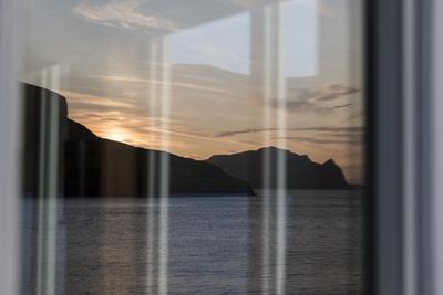 https://imgc.allpostersimages.com/img/posters/faroes-vagar-sundown-window_u-L-Q1EYCUM0.jpg?artPerspective=n