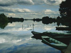 Serenity Creates a Perfect Mirror of the Seine River Near Giverny by Farrell Grehan