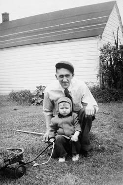 Father and Son Pull a Wagon in Backyard, Ca. 1946