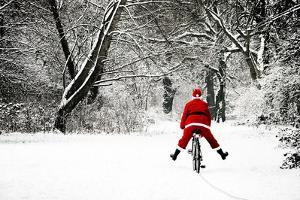 Father Christmas in Snow on Bicycle Freewheeling