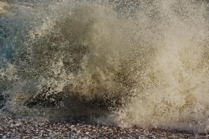 Wave Breaking On Shore, With Yellow-grey Surf by Fay Godwin
