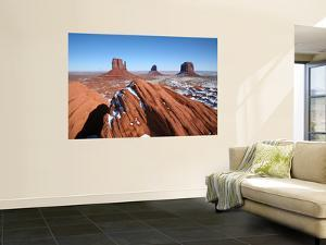 Buttes Towering Above Snowy Desert Floor of Monument Valley by Feargus Cooney