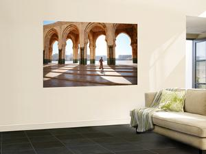 Man Walking Through Hassan Ii Mosque Complex by Feargus Cooney