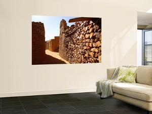 Narrow Alleyway Through Ruins of Desert Town by Feargus Cooney