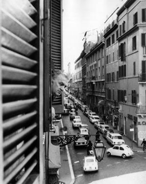 Federico Fellini Standing at a Window