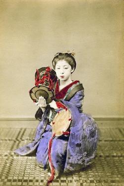 Geisha Playing the Tsuzumi, Japan, 1882 by Felice Beato