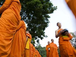 Buddhist Monks on their Morning Walk to Collect Food by Felix Hug