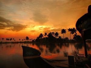 Cruise Boat Bow on Kerala's Backwaters at Sunset by Felix Hug