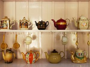 Display of Assorted Tea Pots, Spoons and Strainers at Tea Pot Restaurant by Felix Hug
