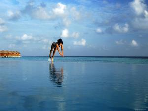 Girl Diving into Pool, Mafushivaru, Ari Atoll, Alifu, Maldives by Felix Hug