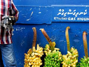 Watch Seller and Bunches of Bananas Outside Vegetable Market, Male, Kaafu, Maldives by Felix Hug