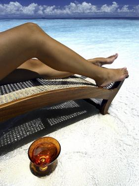 Woman Sunbathing on Beach, Kandholhudu, Ari Atoll, Alifu, Maldives by Felix Hug