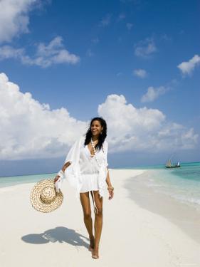 Young Woman Walking on Kuramathi Sandbank, Rashdoo Atoll, Alifu, Maldives by Felix Hug