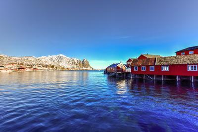 Red Fisherman House in Winter in Reine, Lofoten Islands, Norway