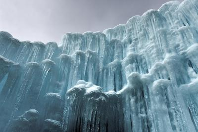 Translucent Blue Icicles in a Frozen Ice Wall