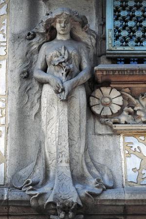https://imgc.allpostersimages.com/img/posters/female-figure-decorative-detail-amatller-house_u-L-PP9PLE0.jpg?p=0
