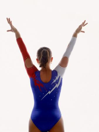 Female Gymnast with Arms Outstretched, Rear View