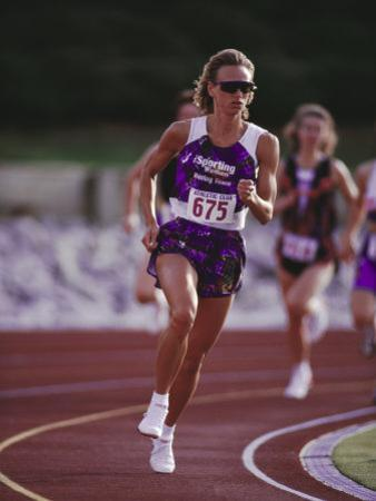 Female Runner Competing in a Track Race
