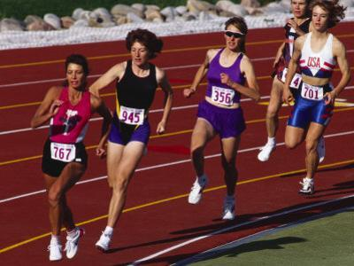 Female Runners Competing in a Track Race