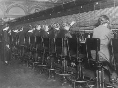 Female Switchboard Operators Connecting Calls
