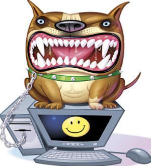 Ferocious Dog Sitting on Computer